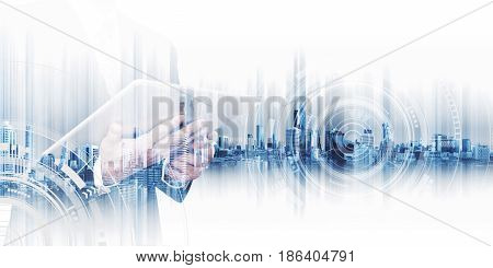 Double exposure businessman working on digital tablet, concepts of business technology network