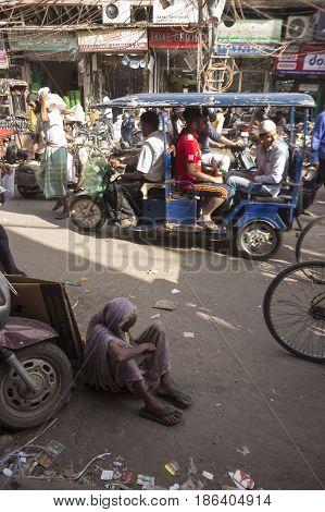 DELHI INDIA-JUL 15 : dirty homeless woman on street in old delhi of Delhi on july 15 2015 india.