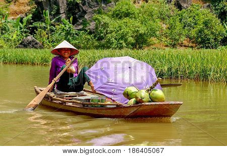 Smiling vendor on the Hoang Long River - Hoa Lu, Vietnam, 10 May 2007