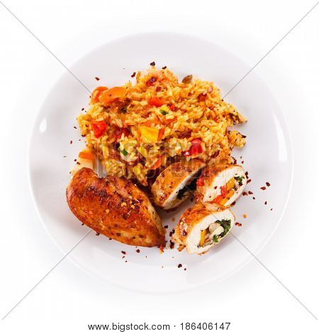 Stuffed chicken fillet with rice and vegetables on white background