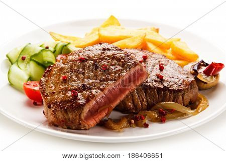 Grilled beefsteak with french fries on white background