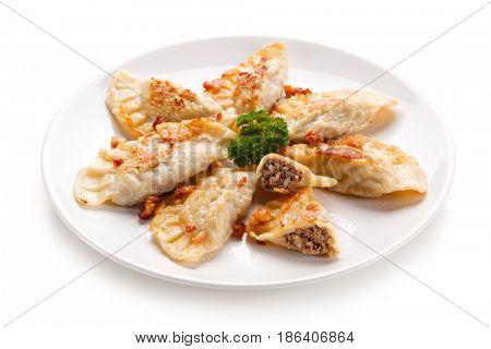 Dumplings - stuffed noodles on white background