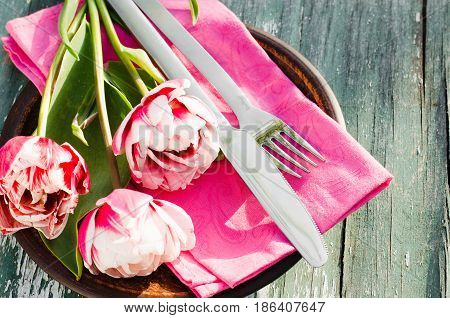 Festive Table Setting With Pink Tulips. Holliday Table Set for Mother's Day or Birthday. Selective Focus.