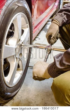 The Mechanic Unscrews The Wheel Wrench