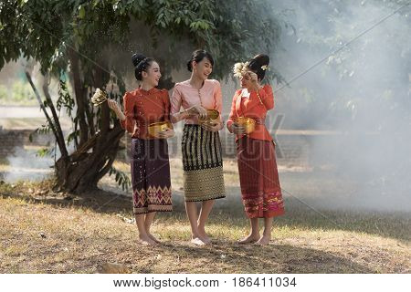 Asian woman wearing traditional Laos culture,vintage style,Laos traditional suit,Laos vintage style,Laos woman sabuydee,Laos dress,Laos
