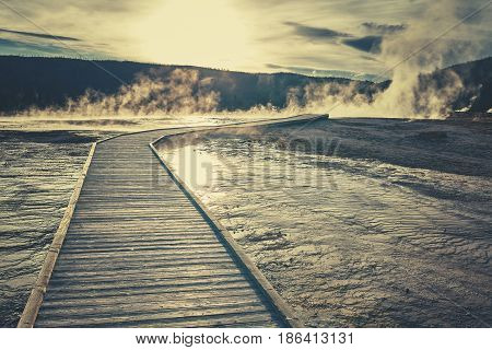 Wooden Bridge Over Steamy Terrain In Yellowstone National Park.