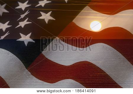 American flag and bright sunshine on ocean - USA patriotic concept