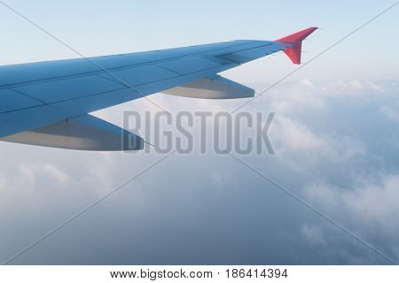 View from the airplane window. Clouds under the wing