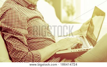 elegant business multitasking multimedia man using devices at home.