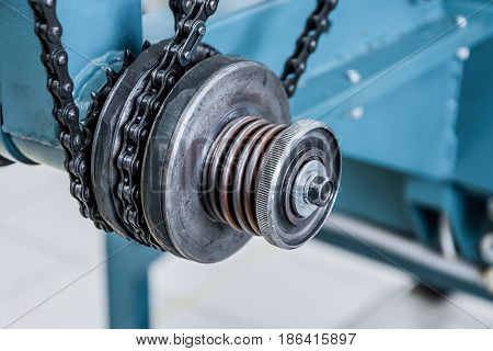 Friction clutch. Chain drive, drive element of braiding machine. Tinted image.