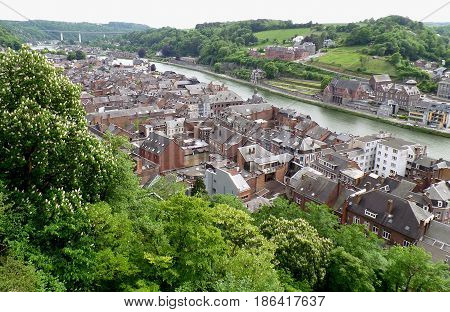 Impressive rooftop view of the vintage buildings along Meuse river, Dinant, Wallonia Region, Belgium