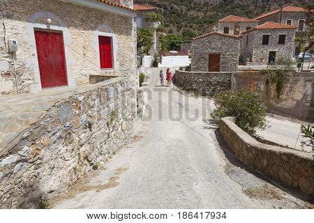 agios dimitrios greece, 28 april 2017: tourists walk in village of agios dimitrios on the coast of messenia in mani part of peloponnese on sunny day in spring