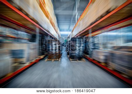 Warehouse industrial and logistics companies. Coiled plastic pipe. Toning the image. Motion blur effect.