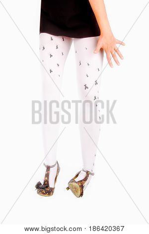 Woman that is walking and wearing high heels sprains her ankle isolated on white