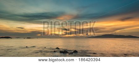A view of Nha Trang bay just after sunrise with a beautiful colourful skyline.