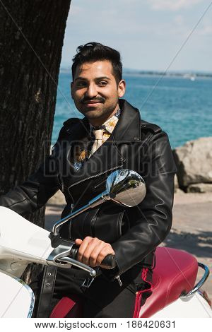 Handsome Man Posing On A Scooter