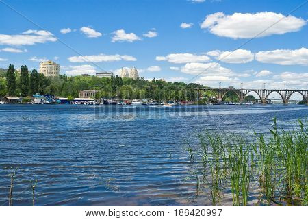 Summer landscape of big Ukrainian city Dnepropetrovsk - view from a river Dnepr.