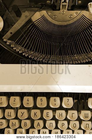 Old retro typewriter vintage background with cyryllic alphabet keys