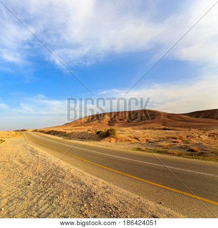 Empty Road In A Mountains In Desert At Sunset