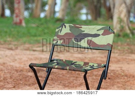 Pickick chairs are located in the garden.
