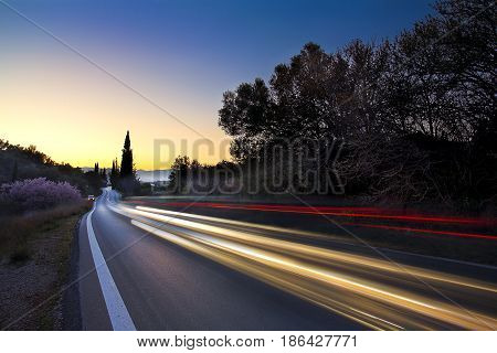 Car lights at night on a motorway in Greece