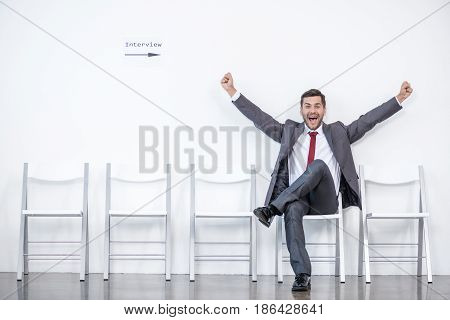 Excited Businessman Sitting And Waiting For Interview In Office, Business Concept