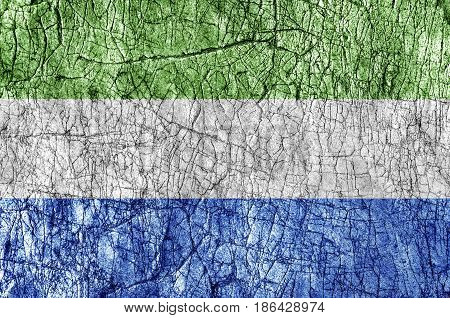 Grudge stone painted Sierra Leone flag close up