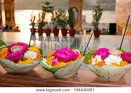 Flowers in leaves ready for a puja at the temple at the Ganga