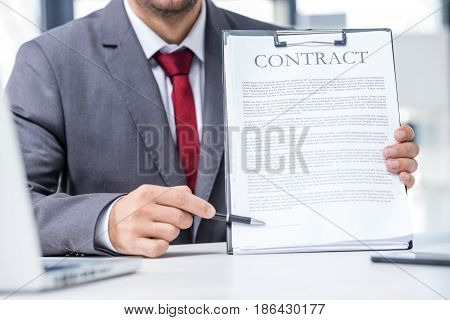 Cropped Shot Of Businessman In Formal Wear Showing Contract, Business Concept