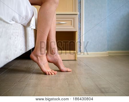 Woman morning gets out of bed. Beautiful woman's legs