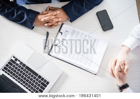Top View Of Businessmen In Formal Wear Sitting At Desk With Contract, Business Concept
