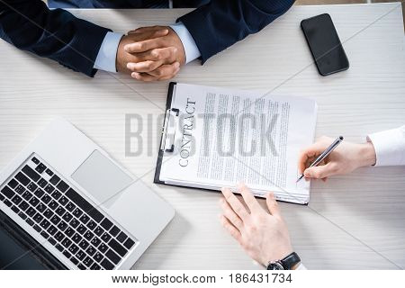 Top Partial View Of Businessman Signing Contract At Workplace