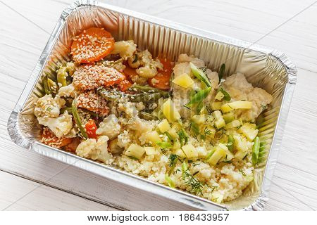 Healthy food, diet concept. Lunch box with Weight loss nutrition closeup. Couscous