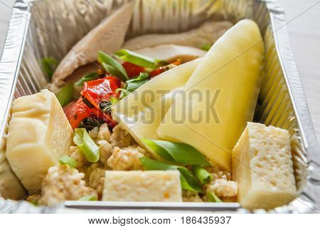Healthy food, diet concept. Lunch box with Weight loss nutrition closeup. Salad with peppers and tofu