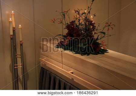 Wooden casket - contemporary style - in a funeral home
