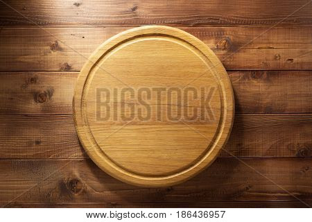 cutting board at wooden plank background