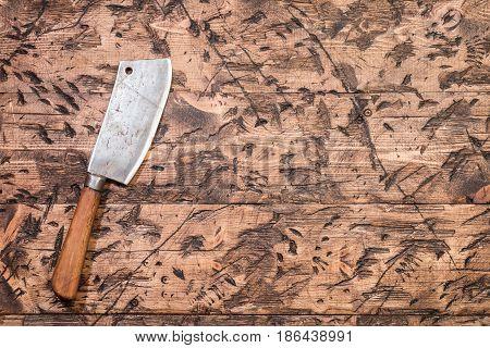 Vintage Meat cleaver on old wooden background