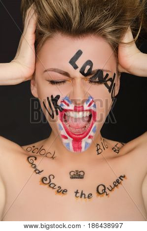 Emotional young woman with english face art black background
