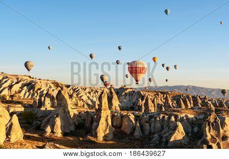 Hot Air Balloons Flying Over Valley In The Morning. Cappadocia. Turkey