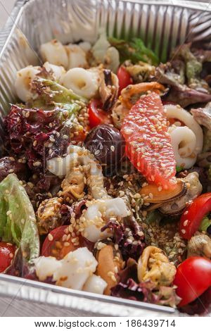 Healthy food, diet. Lunch box with Weight loss nutrition closeup. Seafood salad mix