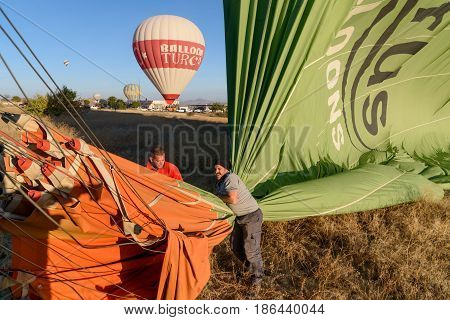 Hot Air Balloon Is Deflated After Landing In The Morning. Cappadocia. Turkey