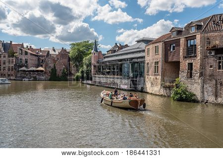 Ghent Belgium - July 31 2016: Canal in the historic center of Ghent with picturesque and industrial old buildings