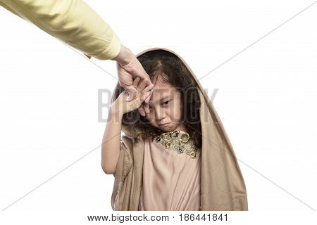 Asian Muslim Child Kissing A Hand Of Her Parents As Respect