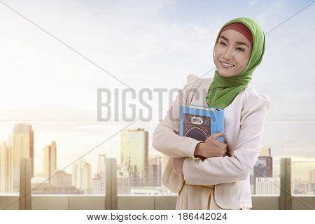 Beautiful Asian Muslim Woman With Hijab Dress Holding Koran