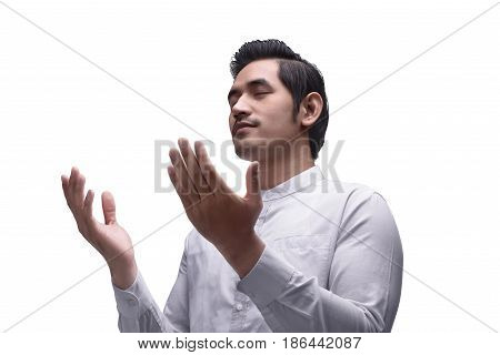 Religious Asian Muslim Man Praying To God