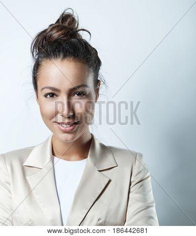 Closeup portrait of confident young businesswoman smiling happy.
