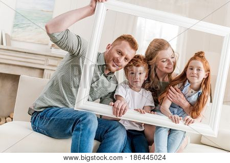Beautiful Happy Redhead Family Sitting Together And Looking Through White Frame, Big Family Portrait