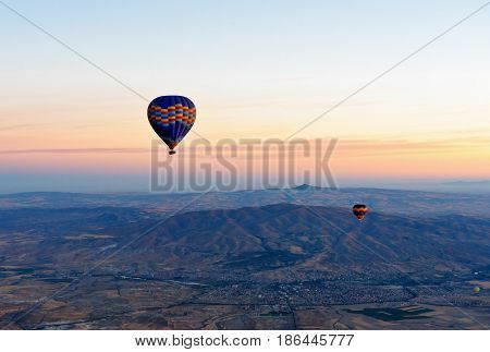 Hot Air Balloons Flying Over Valley At Sunrise. Cappadocia. Turkey