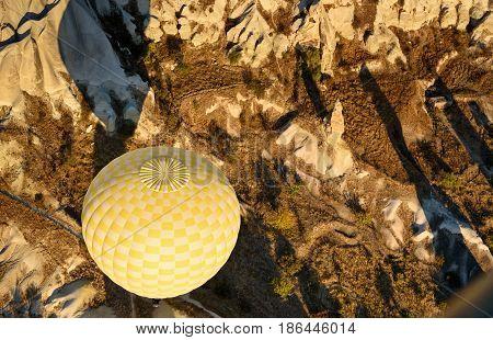 Hot Air Balloon Flying Over Valley In The Morning. Cappadocia. Turkey