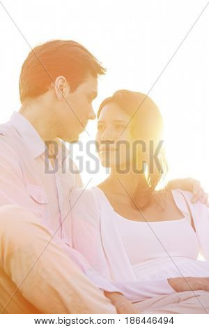 Loving young couple looking at each other against clear sky